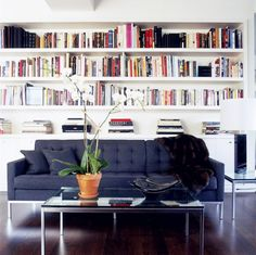 Seating area with bookshelves behind sofa