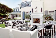 Soooo fabulous that you can't differentiate your indoor living room from your outdoor one. Interior Design by Martyn Lawrence Bullard.