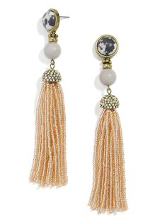 Bold beaded tassels and gem-embellished posts craft kaleidoscopic earrings that totally kill it.