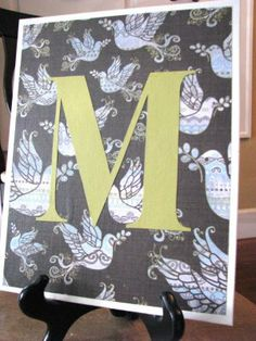 Monogrammed wall art--trace letter and mod podge on fun paper and canvas