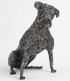 Nirit Levav Art solders and welds discarded bicycle parts together to create adorable dog sculptures.
