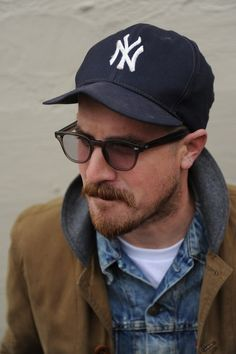 A men's fashion/lifestyle moodboard featuring men's street style looks, beards and various facial hair styles, tattoo art, inspiring street fashion photography, and clothing from the best menswear labels and streetwear brands. Rugged Men, Rugged Style, Baseball Cap Outfit, Baseball Hat, Glasses Outfit, Outfits Hombre, Denim Jacket Men, Denim Jackets, Outfits With Hats