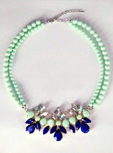 Statement necklace with green beads and blue rhinestones