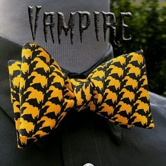 Frightfully fascinating colony of black bats camouflaged in orange. Get your spook on now with this Halloween bat bow tie. Www.bowtieclub.com (Vampire)