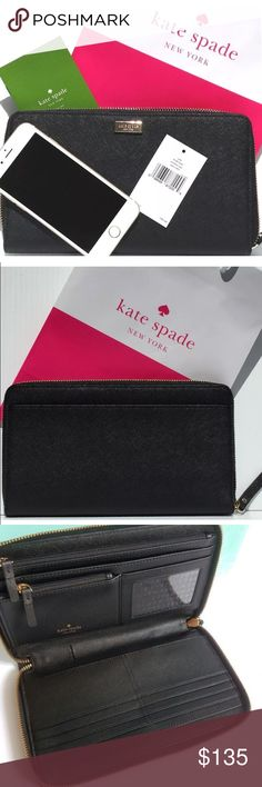 """BNWT Kate Spade - Newbury Lane Talla XL Wallet MSRP: $ 198.00 DESCRIPTION: Size- Measurements Approximately: 9.25"""" (Length) x 5.25"""" (Height) x 1"""" (Depth) Saffiano leather with leather trim Zip around closure 14-karat light gold plated hardware Kate Spade New York gold plate on front  Exterior slide pocket  Fabric lining Eight credit card slots Four billfold full size slots ID window One small zipper coin pocket One full zipper pocket  Four full length bill compartments Pen holder kate spade…"""
