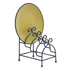 Metal plate rack with scrolling detail.    For decoration. $18.