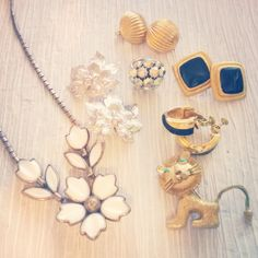 Some vintage pieces: necklace, earrings, ring, and a brooch.