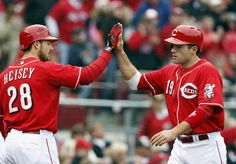 CINCINNATI, OH - APRIL 28: Joey Votto #19 of the Cincinnati Reds celebrates after scoring with Chris Heisey #28 in the first inning against the Houston Astros at Great American Ball Park on April 28, 2012 in Cincinnati, Ohio. (Photo by Matt Sullivan/Getty Images)