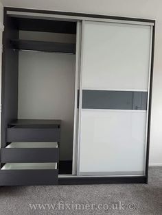 One of our completed projects. Fitted wardrobe, bedside cabinets, dressing table and bed in a combination of white & graphite high gloss. #Fiximer #wardrobes #storage #organisation #interiordesign #furniturefitting #carpentry #bedroom #bespoke #fittedwardobes #mirrordoors #slidingdoors #slidingwardrobes #slidingdoor #Doncaster #Sheffield #Rotherham #Leeds