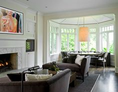 home, residential, living room, dining area, bay windows, couches, fireplace, dark wood floor