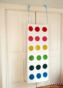 We created this punch box to use for the Candy Button Trivia game we played at our Maddie-licious party. It's pretty easy but does take a little bit of time. You'll need: 4 white poste…