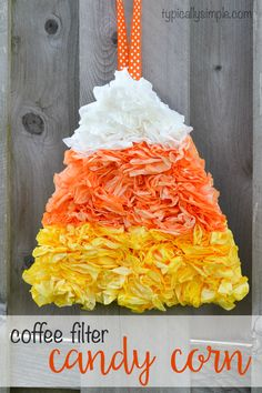 Using dyed coffee filters, this candy corn craft project makes a fun door hanging for Halloween! Using dip-dyed coffee filters, this simple candy corn craft project is such a fun door hanging for Halloween! Coffee Filter Wreath, Coffee Filter Crafts, Coffee Filter Flowers, Coffee Filters, Coffee Filter Projects, Fall Crafts, Holiday Crafts, Holiday Fun, Crafts For Kids