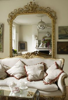 Gold mirror & antique couch... Both must haves!