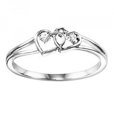 10k white gold double heart ring. Features 2 round diamonds totaling .02cttw set inside a double heart design with split shank. This adorable design also makes a perfect promise ring or commitment rin