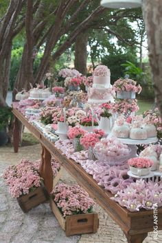 Garden party wedding dessert table filled with gorgeous pink flowers.