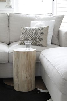Pillow and peeled log side table.