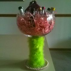 21st birthday gift idea! Just made this for my friend. Decorate a giant martini glass. Fill with a shot glass, Vera Bradley id holder, & many mini alcoholic beverages!