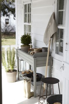pretty deck color palette  Porch potting area that can double as a bar when entertaining