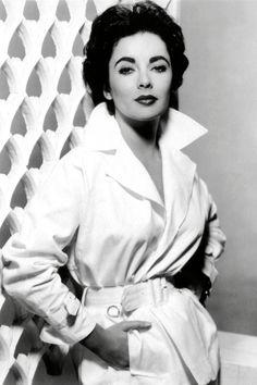 1955   - HarpersBAZAAR.com~ A simple crisp white belted jacket looks amazing!