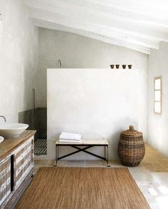 bathroom open space concept with built in wall for shower privacy.