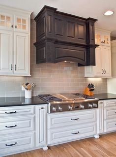 Timeless kitchen with gorgeous custom cabinetry and hood!