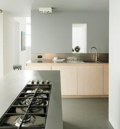 A concrete floor, light wood cabinets, and stainless steel counter tops create a serene feel in the kitchen. Cheap Countertops, Butcher Block Countertops, Laminate Countertops, Concrete Countertops, Kitchen Countertops, Concrete Floor, Butcher Blocks, Home Interior, Kitchen Interior
