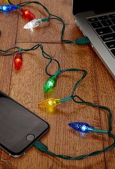 You love this time of year! Show your overzealous holiday spirit with these USB powered holiday lights that double as an iPhone charger. All Things Christmas, Christmas Presents, Christmas Holidays, Christmas Crafts, Christmas Decorations, Christmas Carol, Christmas Mantles, Office Decorations, Victorian Christmas