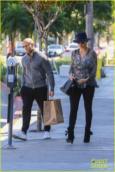 Pregnant Rosie Huntington-Whiteley Cradles Baby Bump While Shopping with Jason Statham