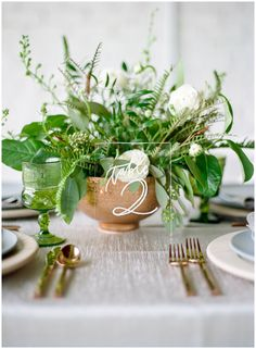 Greenery centerpieces by Amber Veatch Designs || The Ganeys