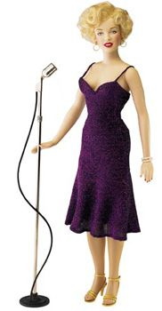 Franklin Mint Marilyn Monroe: Entertaining the Troops, Limited edition of 5,000; dressed in purple dress and comes with microphone; released 2000; original price $195. Z