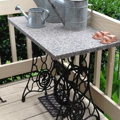 Made out of an old Singer iron base and a piece of granite for my porch. Great to serve on.