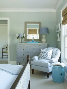 The hotel features 14 rooms and two guest cottages, each designed with luxury and comfort in mind. The guest room above features a chest by Hickory Chair and table lamp by Alexa Hampton for Visual Comfort. Farrow and Ball's Light Blue provides an air of calm to the space.