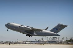 The first of three C-17s to be acquired by the 12-nation Strategic Airlift Capability Program, takes off from Long Beach, Calif., on July 14, beginning its 5,300-nautical-mile maiden flight home to Pápa AB, Hungary. The Hungarian air base is home to the SAC Program's multinational, operational-level unit, the Heavy Airlift Wing, which will officially be activated July 27.
