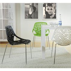 lovie dining chair - made with a polycarbonate seat and back with a chromed steel base.