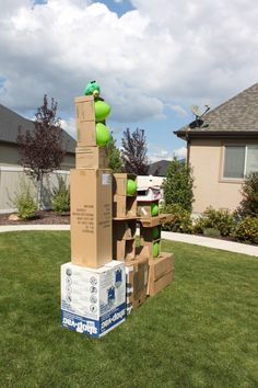 Outdoor angry birds. Stack boxes and put balloons in them.  Use balls is several sizes as the birds to knock over the balloon pigs.
