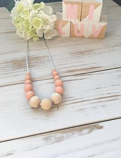 This peach nursing necklace will keep your little one entertained for hours- a great distraction for those restless, inquisitive and curious babies while feeding!  This environmentally friendly necklace is made from 100% food-grade silicone beads and natural untreated eco wood. The necklace is complete with a strong 60cm satin nylon cord and features a safety breakaway clasp, designed to pop open when pulled and tugged on. Open When, Nursing Necklace, New Mums, Teething, Food Grade, Cord, Safety, Peach, Satin