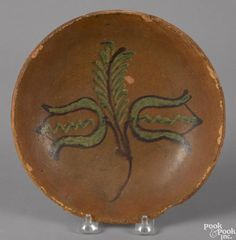 Pennsylvania redware pie plate, 19th c., attributed to the Diehl pottery - Price Estimate: $800 - $1200