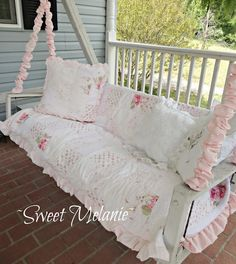 ~Sweet Melanie~ | WWWWWWW there's a suspended swing like this on the porch of the house we just moved into and I would LOVE TO MAKE IT LOOK LIKE THIS!!
