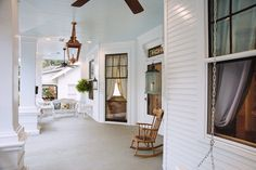 Southern Romance House - Historic Home Renovation in Mobile Alabama - Wicker Patio Furniture and Hanging Ferns on the Porch