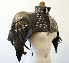 Black Feather, Studded, PVC Leatherette Cape with shoulder pads. By Rachael Forbes (Imaginarium Apparel), via Etsy.