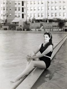 Rita Hayworth, poolside at the Ambassador Hotel, in 1936. At the time this photo was taken, she had signed with Fox as Rita Cansino (her birth name being Margarita Carmen Cansino).