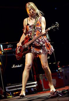 yes, I do believe she's playing bass for the band that invented alternative music.  in wedges.  'nuff said.
