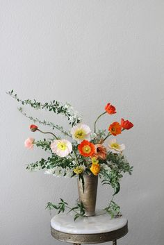 Centerpiece by Honey of a Thousand Flowers 	 	Floral Composition: Icelandic Poppies, Spirea, and Ranunculus