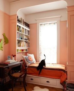 i love this window seat, with a little book shelf behind it!