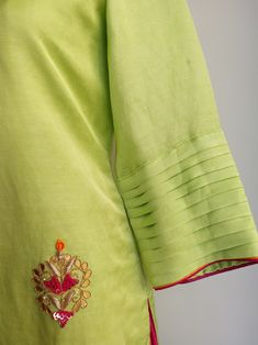 Gota Patti motifs all-over the front Double colour piping on neckline and sleeve Silk Kurti Designs, Simple Kurta Designs, Salwar Neck Designs, Kurta Neck Design, Kurta Designs Women, Kurti Designs Party Wear, Blouse Designs, Kurti Sleeves Design, Sleeves Designs For Dresses