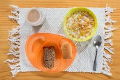 kids breakfasts/ Tiago eats cornflakes, a sweet white bread called bisnagunha, topped with requeijao, a cream cheese, and a slice of banana cake.