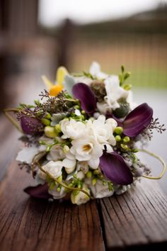 purple mini callas, freesia, seeded eucalyptus and curly willow