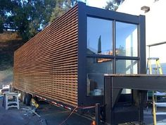 """IQ Haus by DNA European Design Studio was on display at Dwell on Design in Los Angeles, California.  The container home, clad in a contemporary application of Douglas Fir, was enjoyed by conference attendees and could have been the """"coolest thing"""" there."""