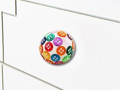 Button Knobs made of wood and metal in bright colors only at https://www.indianshelf.com/category/knobs-handles/