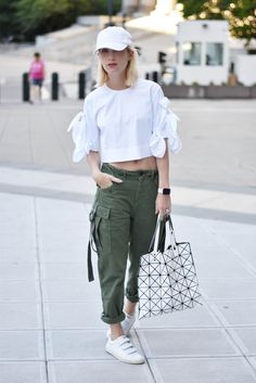 green cargo pants, white blouse, sneakers